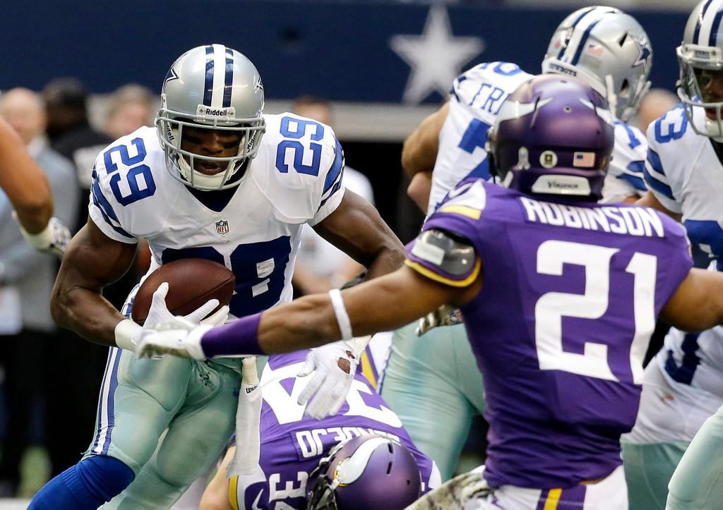 . Dallas Cowboys running back DeMarco Murray (29) looks for running room against Minnesota Vikings cornerback Josh Robinson (21) in the first half of an NFL football game, Sunday, Nov. 3, 2013, in Arlington, Texas. (AP Photo/Nam Y. Huh)