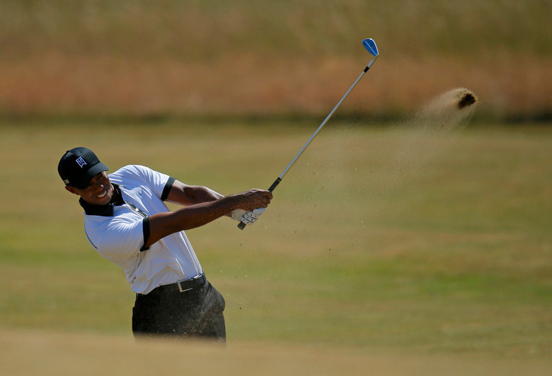 . Tiger Woods of the U.S. plays a shot on the second hole during the first round of the British Open golf championship at Muirfield in Scotland July 18, 2013. REUTERS/Brian Snyder