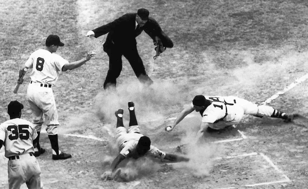 . Cleveland Indians Larry Doby slides across home plate as Boston Red Sox catcher Les Moss, right, attempts to tag him out at Fenway Park in Boston, Ma., June 21, 1951.  (AP Photo)