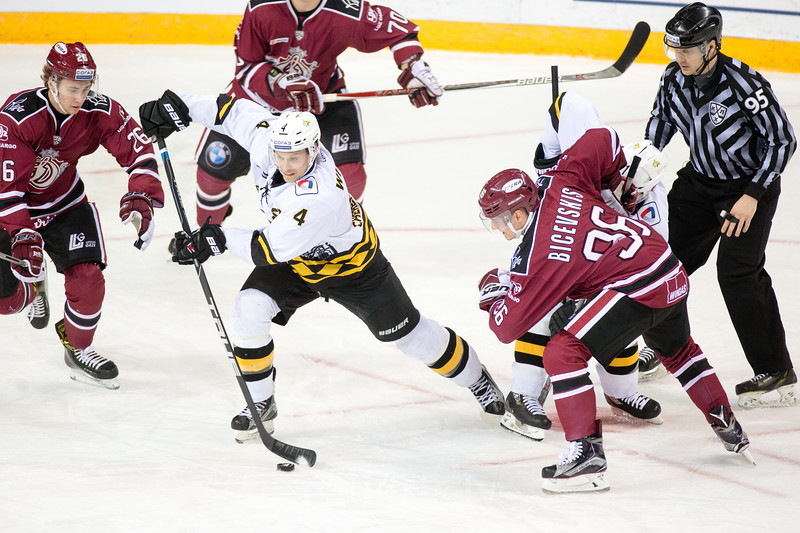 Uvis Balinskis (26) tries to stop Clay Wilson (4) in the KHL regular championship game between Dinamo Riga and Severstal Cherepovets, played on January 3, 2017 in Arena Riga