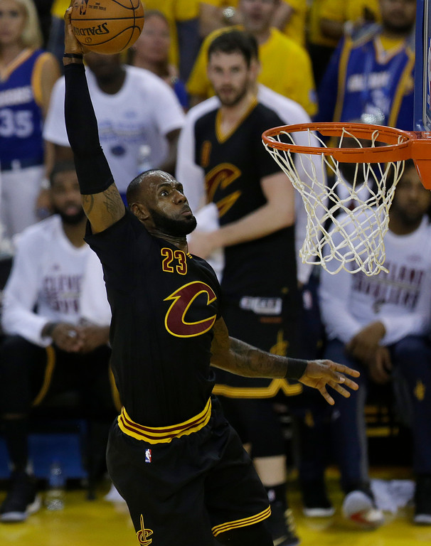. Cleveland Cavaliers forward LeBron James (23) dunks against the Golden State Warriors during the first half of Game 2 of basketball\'s NBA Finals in Oakland, Calif., Sunday, June 4, 2017. (AP Photo/Ben Margot)