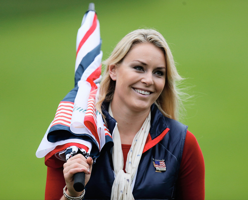 . Olympic Skiier Lindsey Vonn follows the play of Tiger Woods of the U.S. Team during the weather-delayed Day Three Foursome Matches at the Muirfield Village Golf Club on October 6, 2013  in Dublin, Ohio.  (Photo by Gregory Shamus/Getty Images)