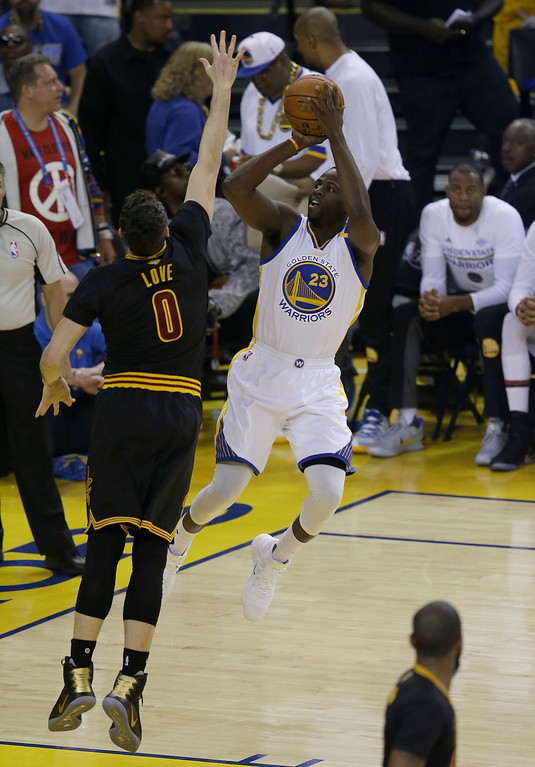 . Golden State Warriors forward Draymond Green (23) shoots against Cleveland Cavaliers forward Kevin Love (0) during the first half of Game 2 of basketball\'s NBA Finals in Oakland, Calif., Sunday, June 4, 2017. (AP Photo/Ben Margot)