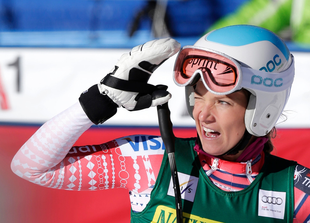 . Julia Mancuso watches the replay of her run during the women\'s World Cup Downhill skiing event, Friday, Nov. 29, 2013, in Beaver Creek, Colo. (AP Photo/Julie Jacobson)