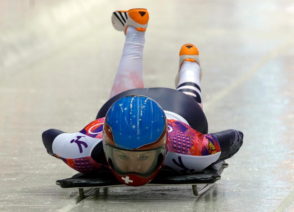 . Marina Gilardoni of Switzerland starts her first run during the women\'s skeleton competition at the 2014 Winter Olympics, Thursday, Feb. 13, 2014, in Krasnaya Polyana, Russia. (AP Photo/Dita Alangkara)