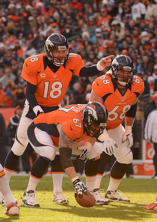 . Denver Broncos quarterback Peyton Manning (18) calls a play from the line in the first quarter as the Denver Broncos took on the Kansas City Chiefs at Sports Authority Field at Mile High in Denver, Colorado on December 30, 2012. John Leyba, The Denver Post