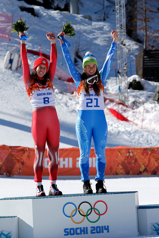 . Dominique Gisin of Switzerland and Tina Maze of Slovenia win joint gold medals during the Alpine Skiing Women\'s Downhill at the Sochi 2014 Winter Olympic Games at Rosa Khutor Alpine Centre on February 12, 2014 in Sochi, Russia. (Photo by Alain Grosclaude/Agence Zoom/Getty Images)