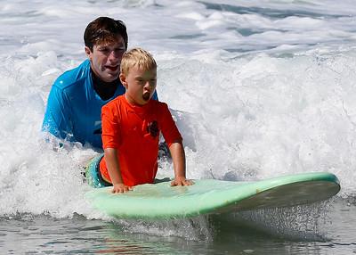 2017_09_23 Surf Camp 24 P2 Boy Blonde Hair Orange Shirt