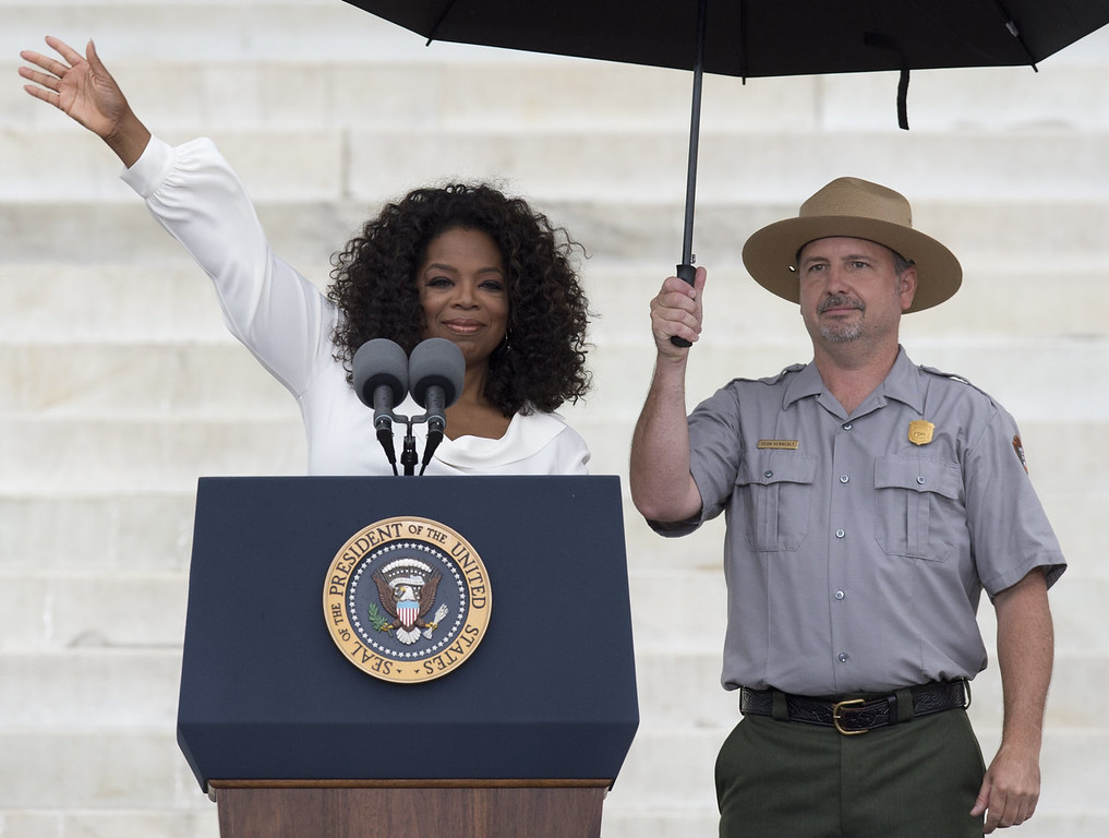 """. Oprah Winfrey speaks during the Let Freedom Ring Commemoration and Call to Action to commemorate the 50th anniversary of the March on Washington for Jobs and Freedom at the Lincoln Memorial in Washington, DC on August 28, 2013. Thousands will gather on the mall on the anniversary of the march and Dr. Martin Luther King, Jr.\'s famous \""""I Have a Dream\"""" speech.   SAUL LOEB/AFP/Getty Images"""