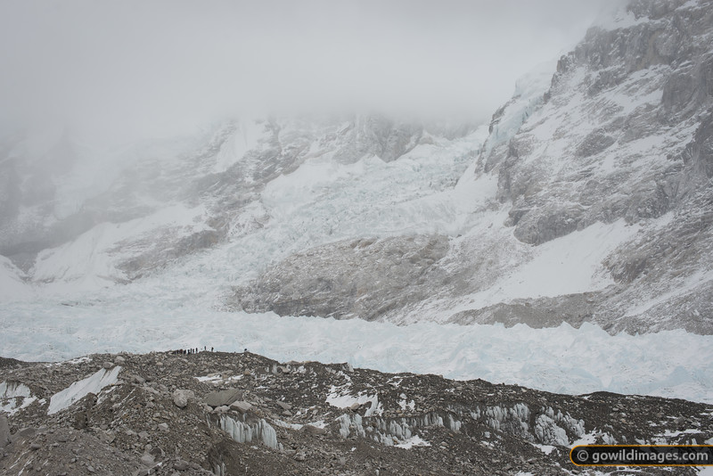 Trekkers at the beginning of base camp, with the Everest icefall behind