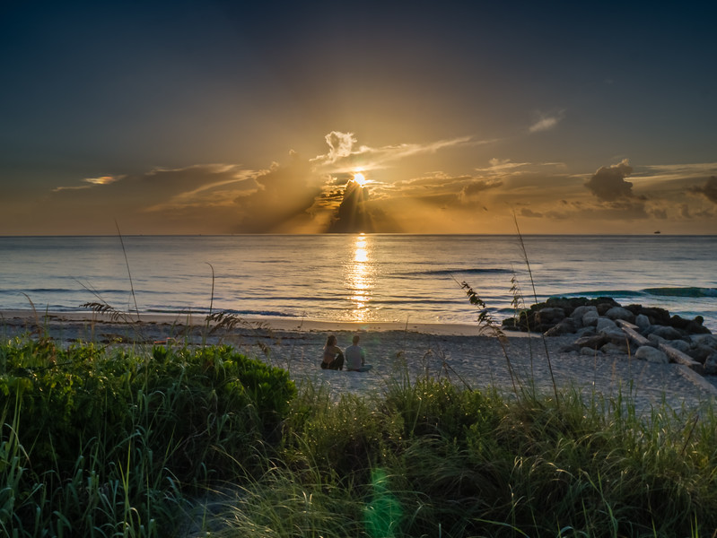 A couple watches as sun rises over Midtown Beach in Palm Beach on Thursday, August 17, 2017. (Joseph Forzano / Deep Creek Images)