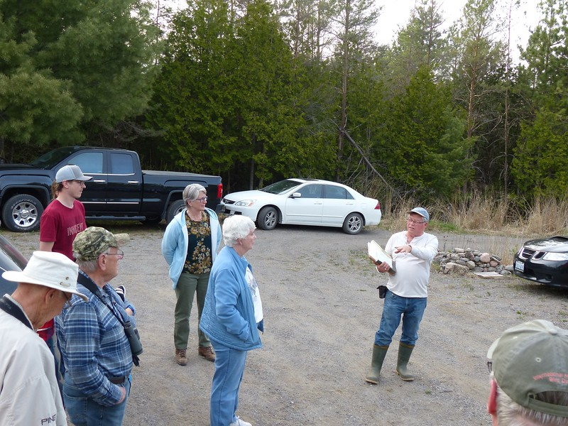 Franks Godfrey speaks to the group about the property and outing