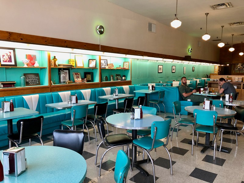 Turquoise chairs and laminate tables at Brent's Drugs in Jackson, MS