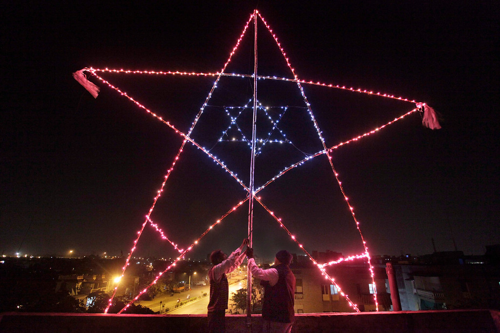 . Indian Christians illuminate a 23-foot huge star on the terrace of their residential building in Ahmadabad, India.  Although Christians comprise only two percent of the Indian population but Christmas is a national holiday and is observed across the country as an occasion to celebrate. (AP Photo/Ajit Solanki)