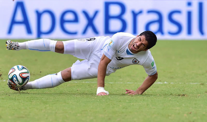 . Uruguay\'s forward Luis Suarez reacts during the Group D football match between Italy and Uruguay at the Dunas Arena in Natal during the 2014 FIFA World Cup on June 24, 2014.  GIUSEPPE CACACE/AFP/Getty Images