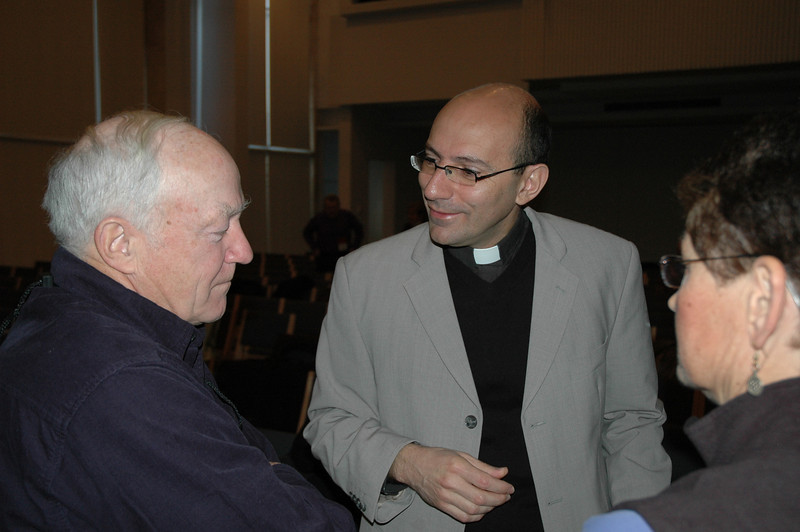 The Rev. Mitri Raheb, center, talks with John Payne, husband of ELCA New England Synod bishop Margaret Payne, Jan. 10 in Bethlehem.