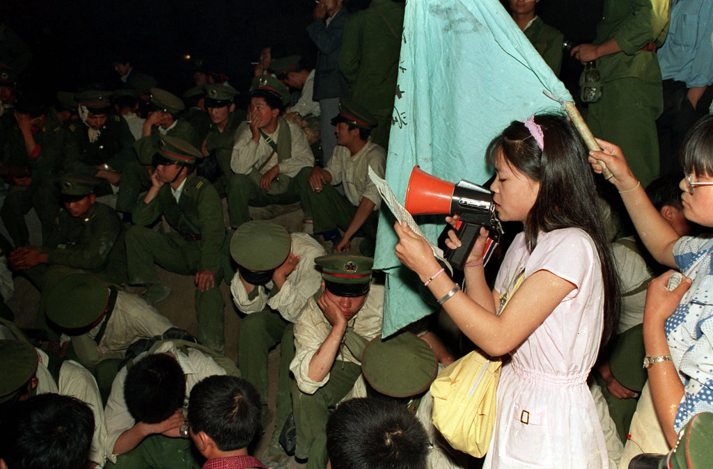 . A student from Beijing Normal University reads a pro-democracy statement to Chinese troops trapped by Beijing residents after being stopped on their way to Tiananmen Square in this June 3, 1989 photo.  (AP Photo/Mark Avery)