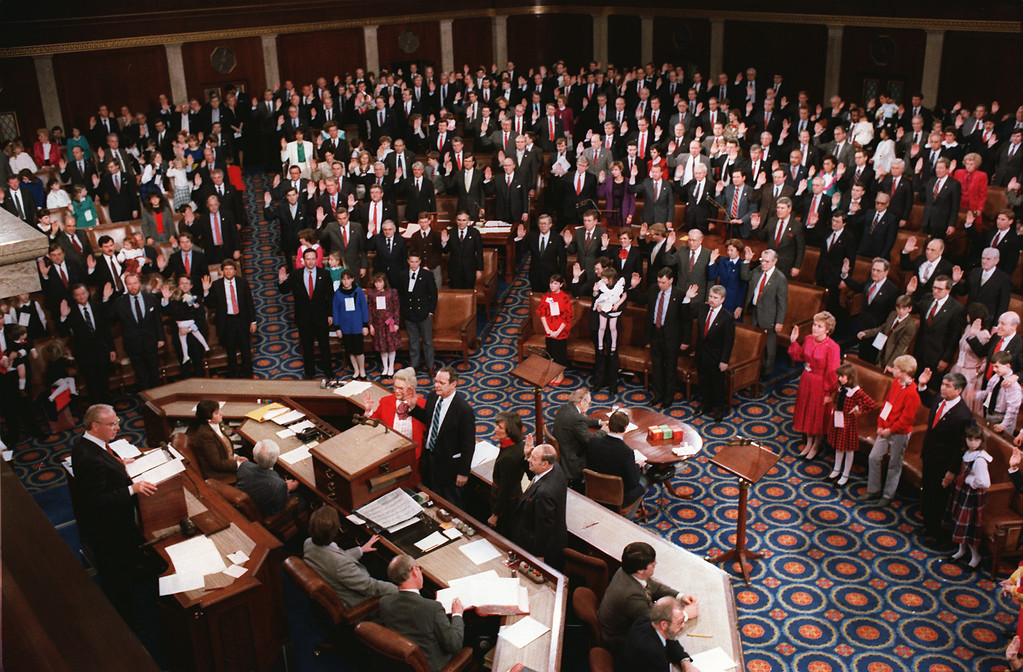 . The new U.S. Speaker of the House of Representatives Jim Wright of Texas, left, swears in the members of the 100th session of Congress during ceremonies on Capitol Hill in Washington, D.C., Tuesday  on Jan. 6, 1987.  (AP Photo/John Duricka)