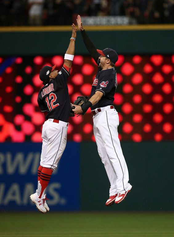 . Cleveland Indians\' Francisco Lindor, left, and Lonnie Chisenhall celebrate after Game 2 against the Boston Red Sox in a baseball American League Division Series, Friday, Oct. 7, 2016, in Cleveland. Cleveland won 6-0. (AP Photo/Aaron Josefczyk)