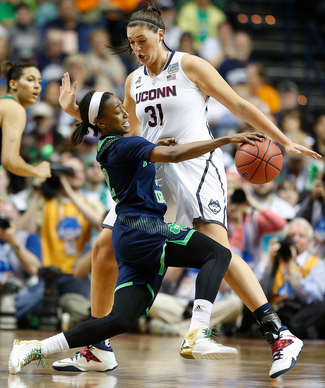 . Notre Dame guard Jewell Loyd (32) tries to get through Connecticut center Stefanie Dolson (31) during the second half of the championship game in the Final Four of the NCAA women\'s college basketball tournament, Tuesday, April 8, 2014, in Nashville, Tenn. (AP Photo/John Bazemore)