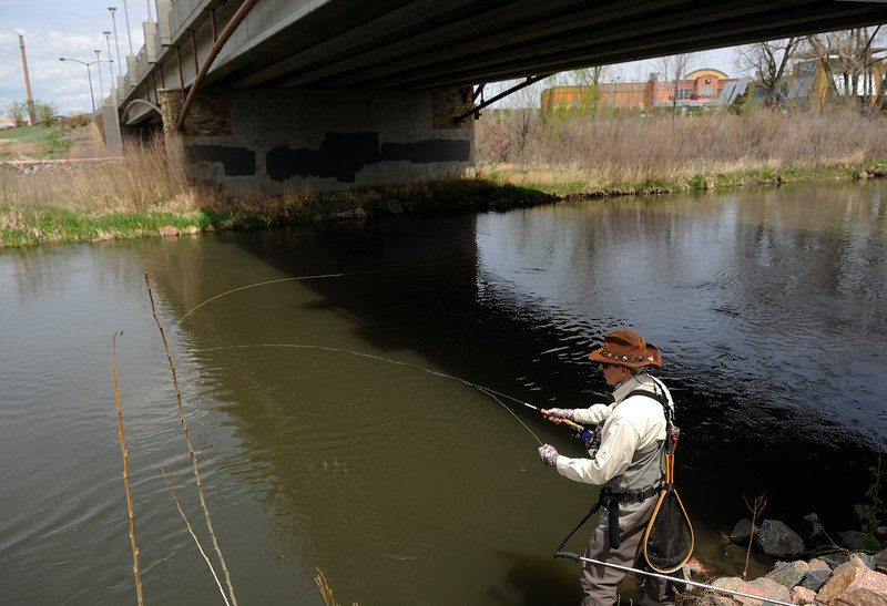 . Urban fishing on Monday, May 13, 2013 along the South Platte River in Sheridan, CO  as  John Davenport casts from under the River Point Parkway bridge.  (Photo By Cyrus McCrimmon/The Denver Post)