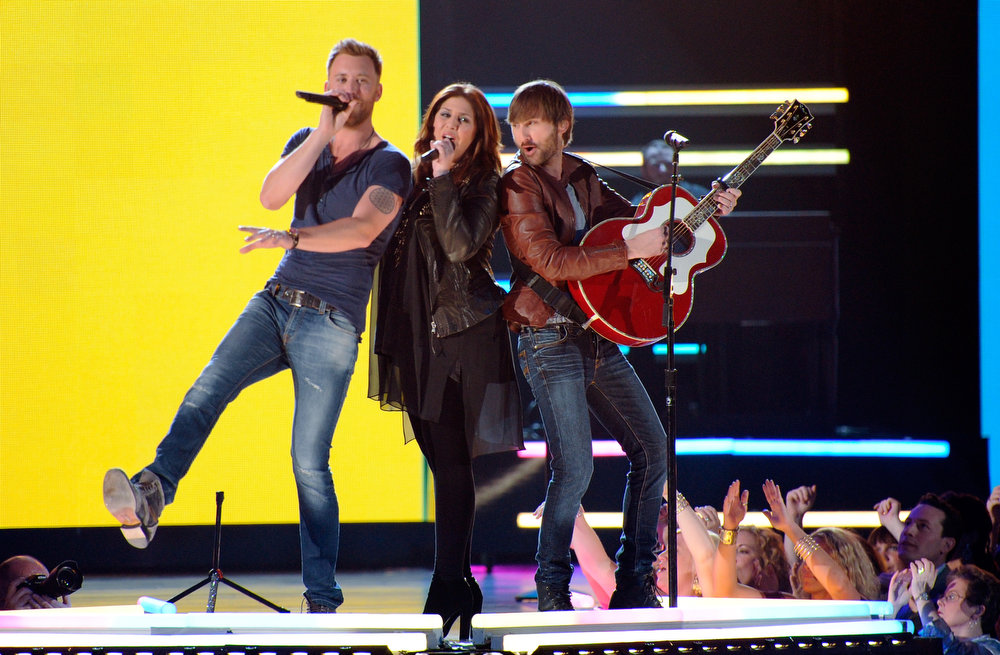 . Singers Charles Kelley, Hillary Scott, and Dave Haywood of Lady Antebellum perform onstage during the 48th Annual Academy of Country Music Awards at the MGM Grand Garden Arena on April 7, 2013 in Las Vegas, Nevada.  (Photo by Ethan Miller/Getty Images)