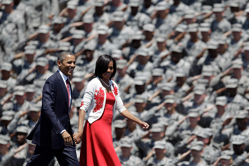 . President Barack Obama and first lady Michelle are saluted by soldiers as they arrive at the Fort Stewart Army post, Friday, April 27, 2012, in Fort Stewart, Ga. (AP Photo/David Goldman)