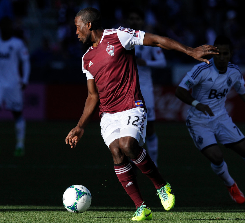 . COMMERCE CITY, CO. - OCTOBER 19: Colorado midfielder Hendry Thomas (12) turned with the ball in the first half. The Colorado Rapids defeated the Vancouver Whitecaps 3-2 at Dick\'s Sporting Goods Park Saturday, October 19, 2013. Photo By Karl Gehring/The Denver Post