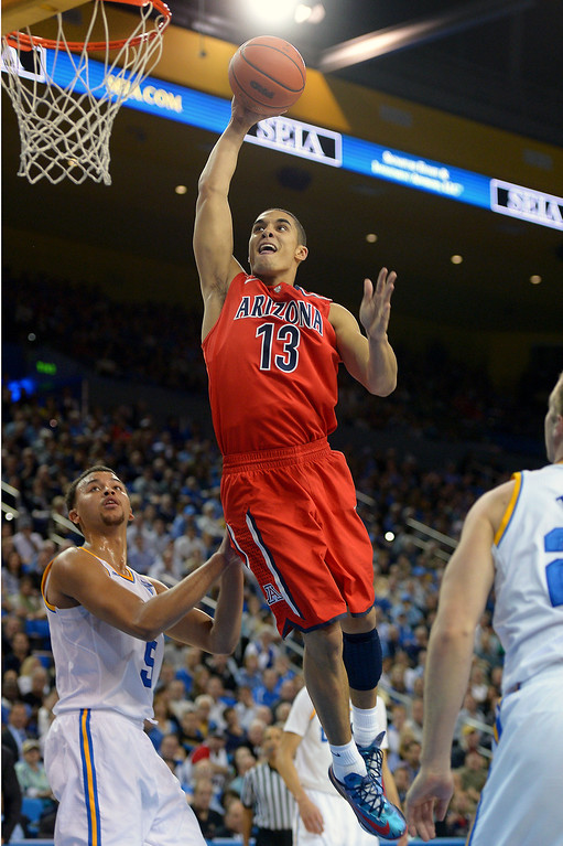 . Arizona\'s Nick Johnson goes high for a dunk over UCLA\'s Kyle Anderson in the second half, Thursday, January 9, 2014, at Pauley Pavilion. (Photo by Michael Owen Baker/L.A. Daily News)