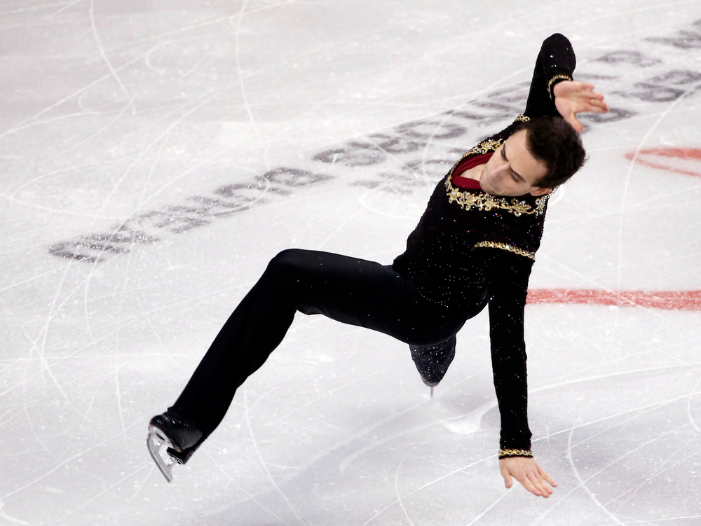 . Stephen Carriere falls as he skates in the men\'s free skate at the U.S. Figure Skating Championships in Boston, Sunday, Jan. 12, 2014. (AP Photo/Elise Amendola)