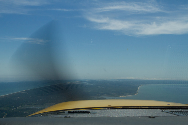 Approximately over Provincetown, looking south towards Chatham (at the edge of low clouds and fog).
