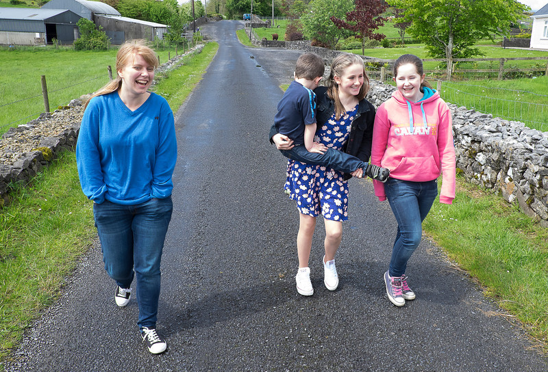 Our Kate (left) walking back to the house after the cow adventure with Helen's daughter Kate who is holding Oisin and Erin.