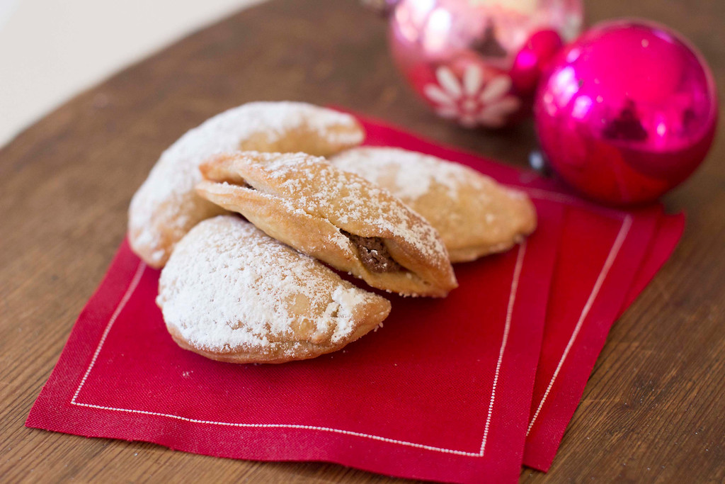 ". The trick with making the healthier cookie is to use real ingredients, but to keep everything in moderation. <a href=""http://www.tampabay.com/news/health/enjoy-chocolate-almond-crescent-cookies-without-any-guilt/2208098\"">Get the recipe for chocolate almond crescent cookies</a>. (AP Photo/Matthew Mead)"