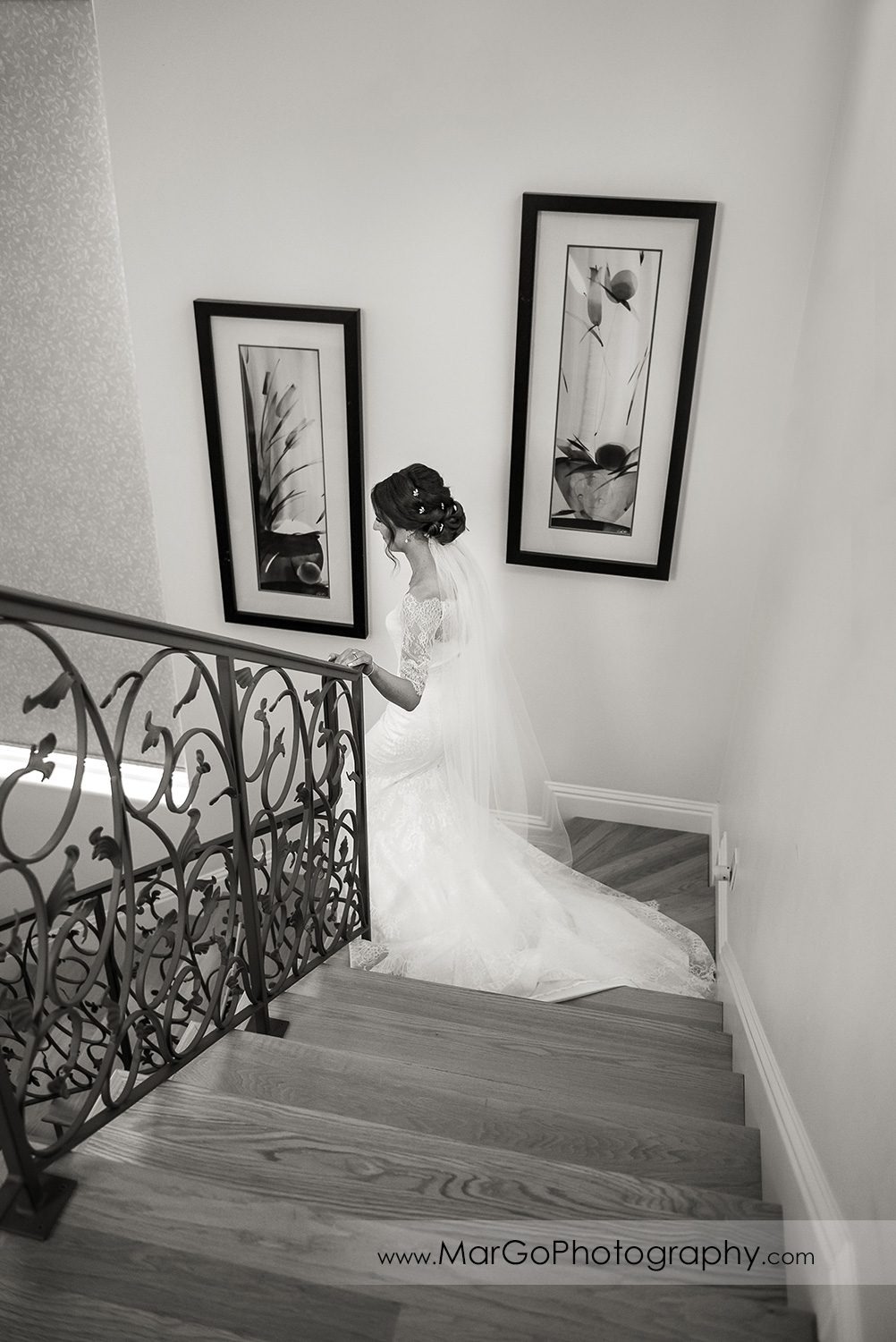 bride walking down the stairs during first look in Walnut Creek