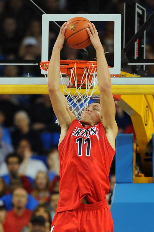 . Arizona\'s Aaron Gordon dunks off a lob against UCLA, Thursday, January 9, 2014, at Pauley Pavilion. (Photo by Michael Owen Baker/L.A. Daily News)