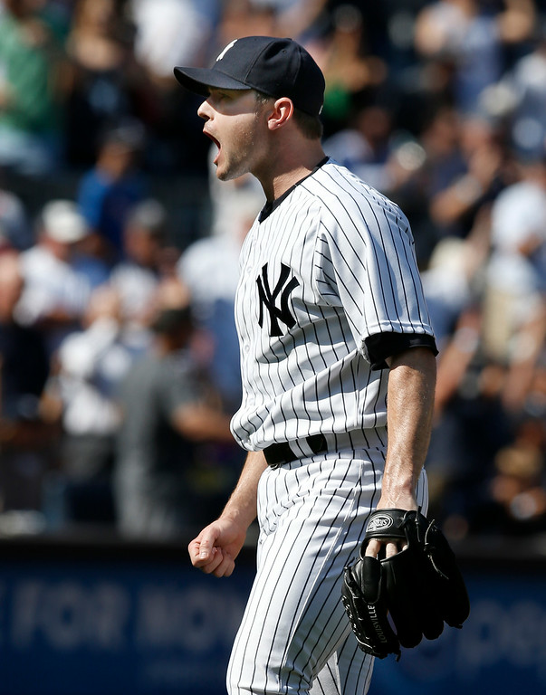 . New York Yankees relief pitcher David Robertson (30) reacts after Detroit Tigers Don Kelly popped out for the final out in the Yankees 1-0 victory over the Tigers in a baseball game at Yankee Stadium in New York, Thursday, Aug. 7, 2014.  (AP Photo/Kathy Willens)
