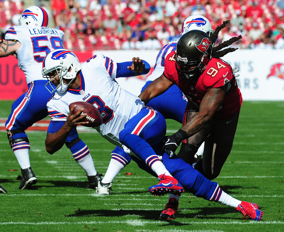 . EJ Manuel #3 of the Buffalo Bills is pressured by Adrian Clayborn #94 of the Tampa Bay Buccaneers at Raymond James Stadium on December 8 2013 in Tampa, Florida. (Photo by Scott Cunningham/Getty Images)