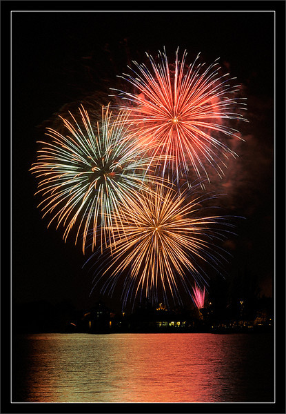 Shoreline Fourth Fireworks  Indepedence Day fireworks over Shoreline Boathouse and Shoreline Lake  Shoreline Park Mountain View, California  04-JUL-2010