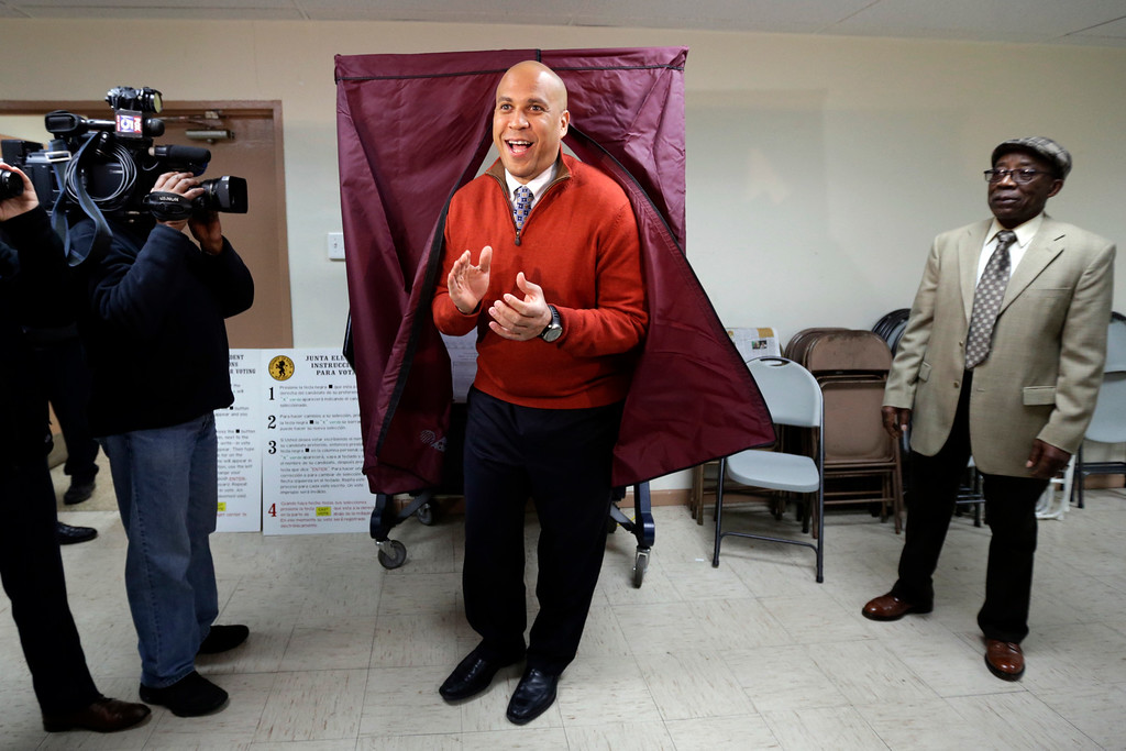 . Sen. Cory Booker, D-N.J.,  applauds while exiting a voting booth after casting his vote in the 2014 general election, Tuesday, Nov. 4, 2014, in Newark, N.J.  Booker is going up against Republican challenger Jeff Bell. (AP Photo/Julio Cortez)