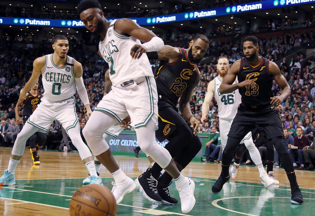 . Cleveland Cavaliers forward LeBron James, right, loses control of the ball past of Boston Celtics guard Jaylen Brown (7) during the first half in Game 7 of the NBA basketball Eastern Conference finals, Sunday, May 27, 2018, in Boston. (AP Photo/Elise Amendola)