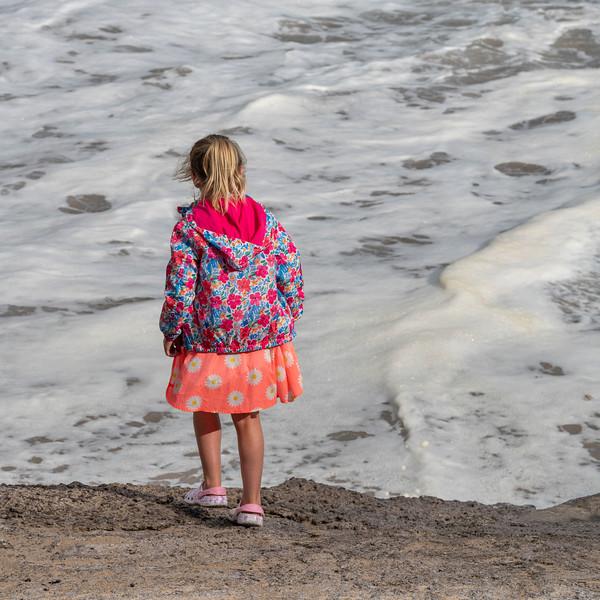 Rear view of a girl walking along the ocean, Ballyferriter, County Kerry, Ireland