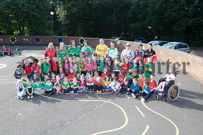 St Ronans PS held a GAA funday and a sponsored skip recently. Pictured with Gillian Fitzpatrick Chairperson of Newry, Mourne and Down DC and Principal Kevin Donaghy are Primary 1 pupils and teachers. R1638008