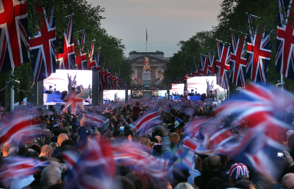 . A large crowd fills The Mall in front of Buckingham Palace to watch The Diamond Jubilee Concert on June 4, 2012 in London, England. For only the second time in its history the UK celebrates the Diamond Jubilee of a monarch. Her Majesty Queen Elizabeth II celebrates the 60th anniversary of her ascension to the throne. Thousands of well-wishers from around the world have flocked to London to witness the spectacle of the weekend\'s celebrations. The Queen along with all members of the royal family will participate in a River Pageant with a flotilla of a 1,000 boats accompanying them down The Thames.  (Photo by Peter Macdiarmid/Getty Images)