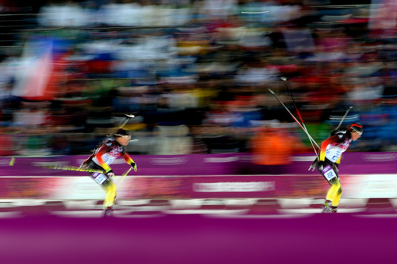 . Evi Sachenbacher-Stehle of Germany and Andrea Henkel of Germany compete in the Women\'s 10 km Pursuit during day four of the Sochi 2014 Winter Olympics at Laura Cross-country Ski & Biathlon Center on February 11, 2014 in Sochi, Russia.  (Photo by Harry How/Getty Images)