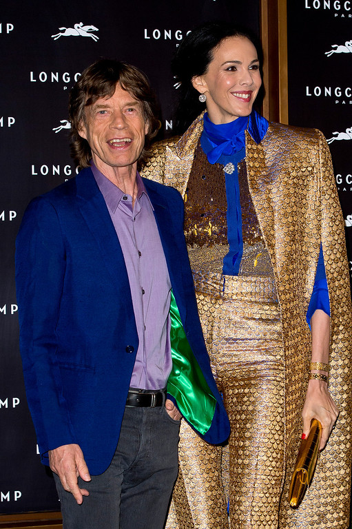 . (L-R) L\'Wren Scott and Mick Jagger attend the grand opening party of Longchamp Regent Street on September 14, 2013 in London, England.  (Photo by Ben A. Pruchnie/Getty Images)