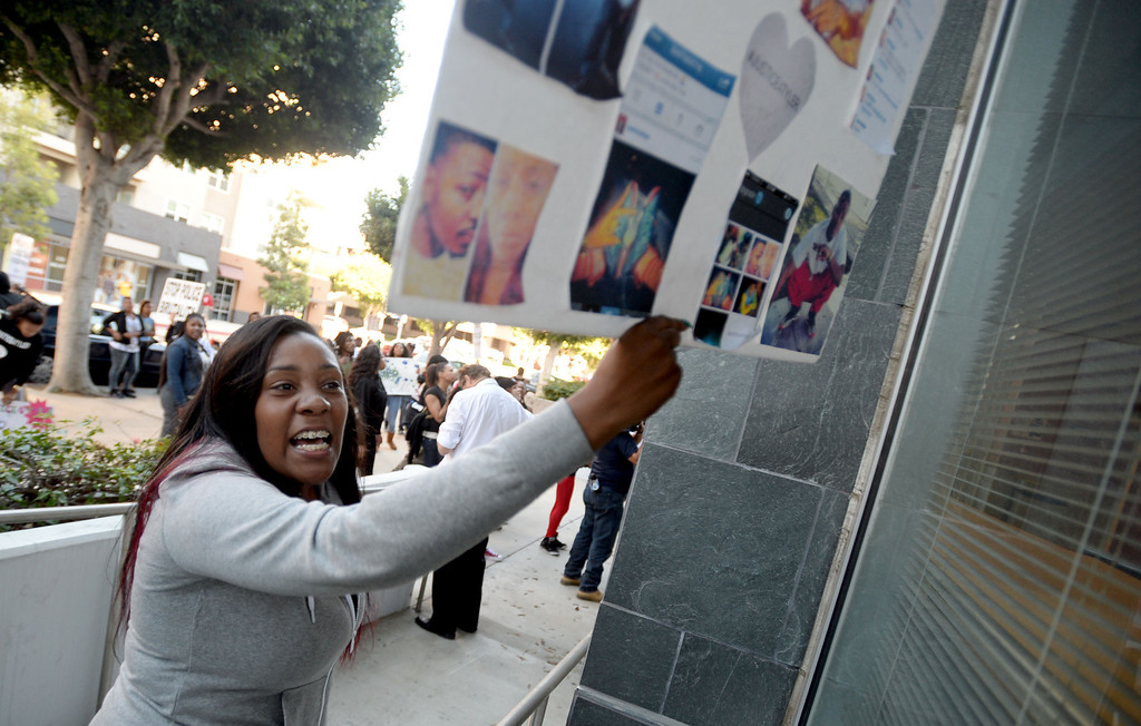 . Rickie Watts, girlfriend of Tyler Woods, who was shot by the Long Beach Police Department on Nov. 19, protests his shooting death outside the police department headquarters in Long Beach on Sunday, November 24, 2013. (Photo by Sean Hiller/ Daily Breeze).