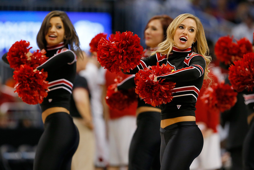 . The Louisville Cardinals cheerleaders perform while taking on the Saint Louis Billikens during the third round of the 2014 NCAA Men\'s Basketball Tournament at Amway Center on March 22, 2014 in Orlando, Florida.  (Photo by Kevin C. Cox/Getty Images)