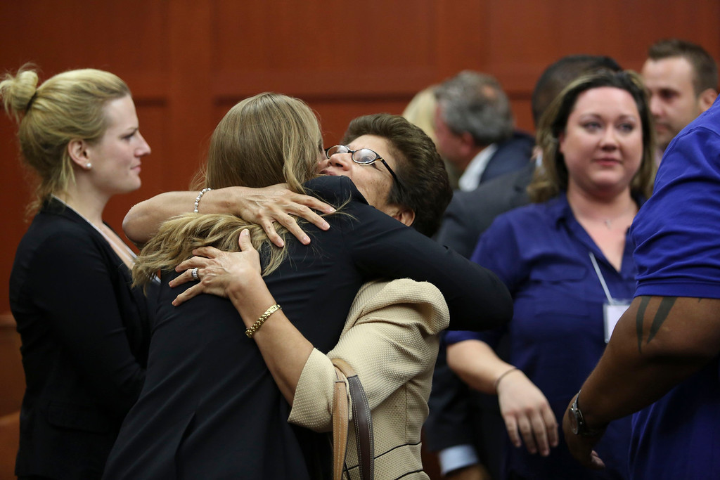 . George Zimmerman\'s family celebrates after the jury found him not guilty in the 2012 shooting death of Trayvon Martin at the Seminole County Criminal Justice Center in Sanford, Florida, July 13, 2013. Zimmerman was acquitted of all charges on Saturday for the fatal shooting of unarmed black teenager Trayvon Martin in this central Florida town in February of last year.  REUTERS/Gary W. Green/Pool