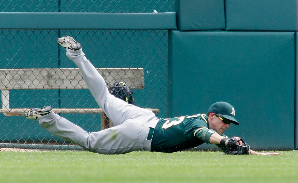 . Oakland Athletics left fielder Sam Fuld makes a hits the field after making a sliding catch of a fly ball hit by Detroit Tigers\' J.D. Martinez during the second inning of a baseball game at Comerica Park Thursday, June 4, 2015, in Detroit. (AP Photo/Duane Burleson)