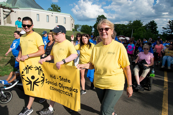 07/24/19 Wesley Bunnell | Staff Participants leave the start line at the start of the Walk and Roll on Wednesday afternoon at Walnut Hill Park. The Walk and Roll is hosted by the citys Commission on Persons with Disabilities and celebrates the signing of the American with Disabilities Act of 1990 and serves to raise awareness for improving the quality of life for all residents in the city, regardless of disability.